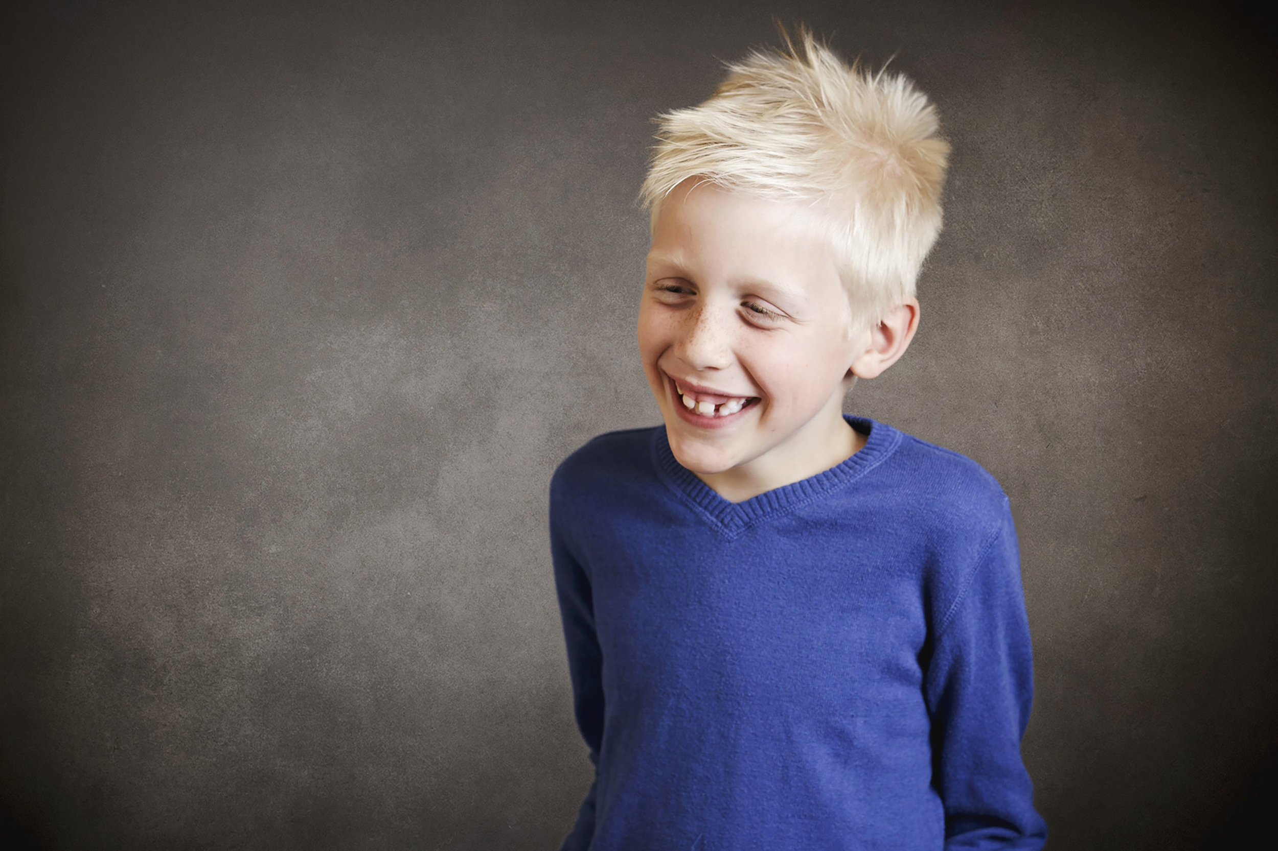 young-blond-boy-giggling-to himself-child-photographer-surrey